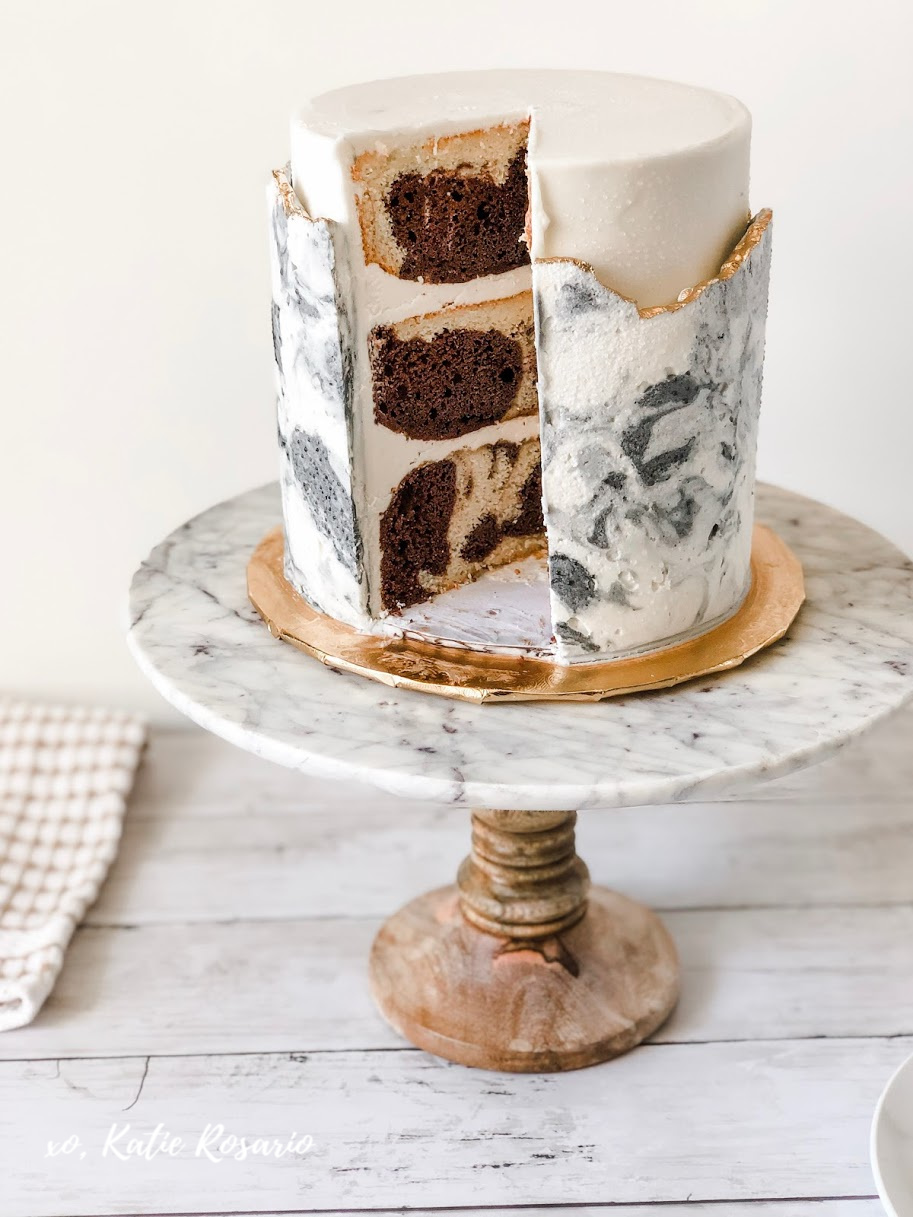 Need some new cake inspiration? This marble buttercream cake is made from simple techniques that makes an impressive cake. With the marble streaks inside and out the different colors make the buttercream look like real marble stone! Learn how to make your own modern marble buttercream cake for beginner bakers! #xokatierosario #cakedecoratingtipsandtricks #marblebuttercreamcake #marblecaketutorial