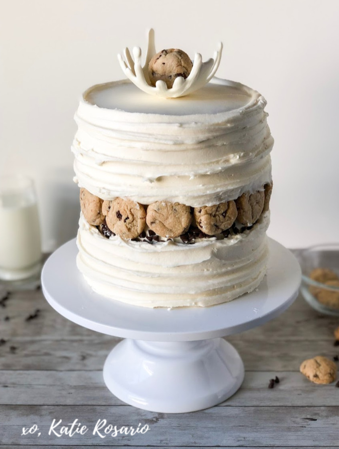 Looking for whimsical cake ideas that kids of all ages will love? Learn how to make this super fun milk and cookies cake. You'll learn how to make a white chocolate milk splash that will impress your friends and family. This cake decorating tutorial is fun and creative which is perfect for any celebration! #xokatierosario #cakedecoratingtipsandtricks #milkandcookiescake #chocolatechipcookiedough #chocolatecookiecake