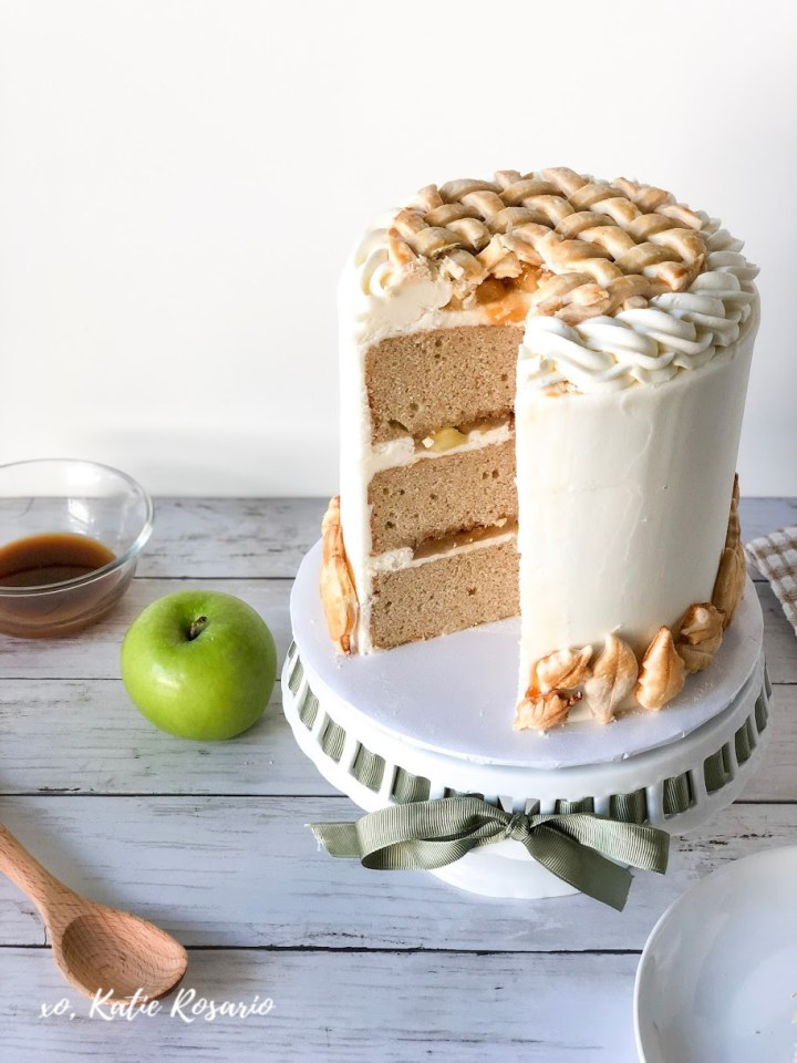 Learn how to make this Apple Pie Cake with this easy tutorial! Now you don't have to choose between a cake or a pie because you can so easily have them together. This apple pie cake recipe will soon become a crowd favorite. This apple pie cake is perfect for Thanksgiving. #xokatierosario #applepiecake #applepiecakerecipes #fallbakingideas #cakedecoratingtipsandtricks