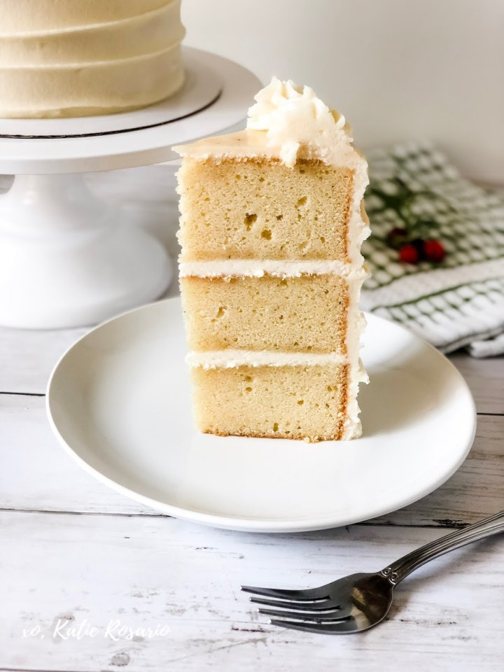 Simple Eggnog cake recipe that's the perfect Christmas dessert. This classic Eggnog drink lends itself easily to be turned into a decadent dessert. I wanted to keep the cake design simple, so you can focus on the flavor that packs a real punch! Now you'll be able to snuggle up with a blanket and enjoy a cup or a slice of this eggnog cake! #xokatierosario #eggnogcakerecipe #eggnogrumcake #creamcheesebuttercream #cakedecoratingtips