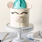 I don't know what it is, but animal theme cakes will always be adorable, and I will never get tired of them. This Polar Bear Cake is made with soft vanilla cake layers and creamy vanilla buttercream. The fondant decorations are what makes this cake so adorable. Here's how to make this Polar Bear Cake that's Instagram worthy! #xokatierosario #katierosariocake #polarbearcake #cakedecoratingtips #cakedecoratingforbeginners