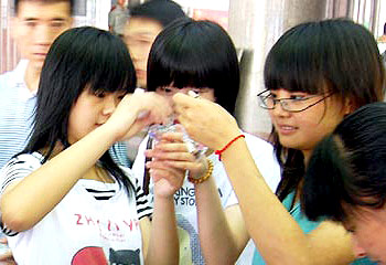Chinese teens with fish necklaces