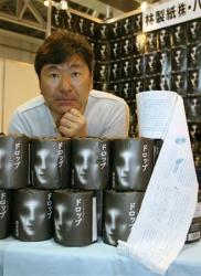 koji-suzuki-drop-toilet-paper
