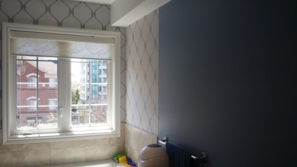 washroom with wall paper
