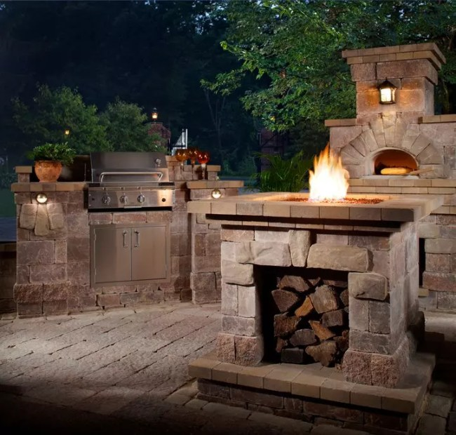 outdoor grill area with woodfired pizza oven