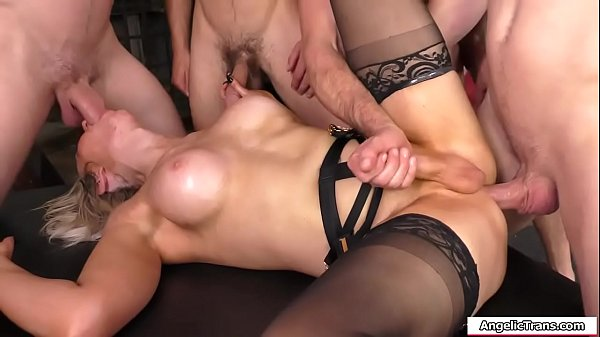 Busty shemale barebacked by 4 big cocks