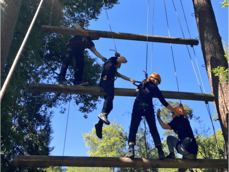 Kids working together to climb Jacobs ladder at Xtreme's Adventure Summer Camp.