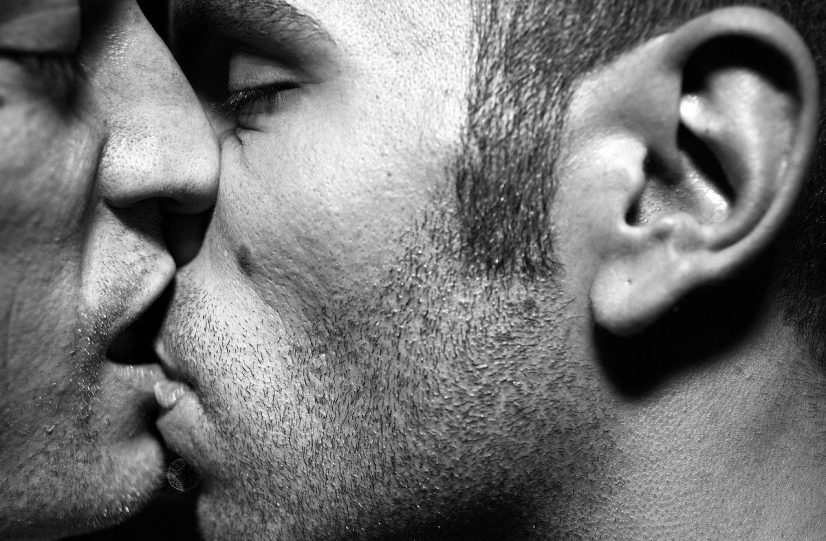 Men Romantically Kissing