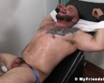 Tattooed stud got his tiny cock tickled while restrained