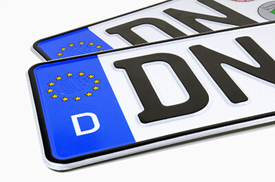 Embossed number plate reflective sheeting