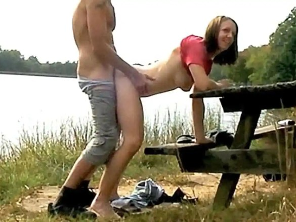 Couple fucking on picnic table