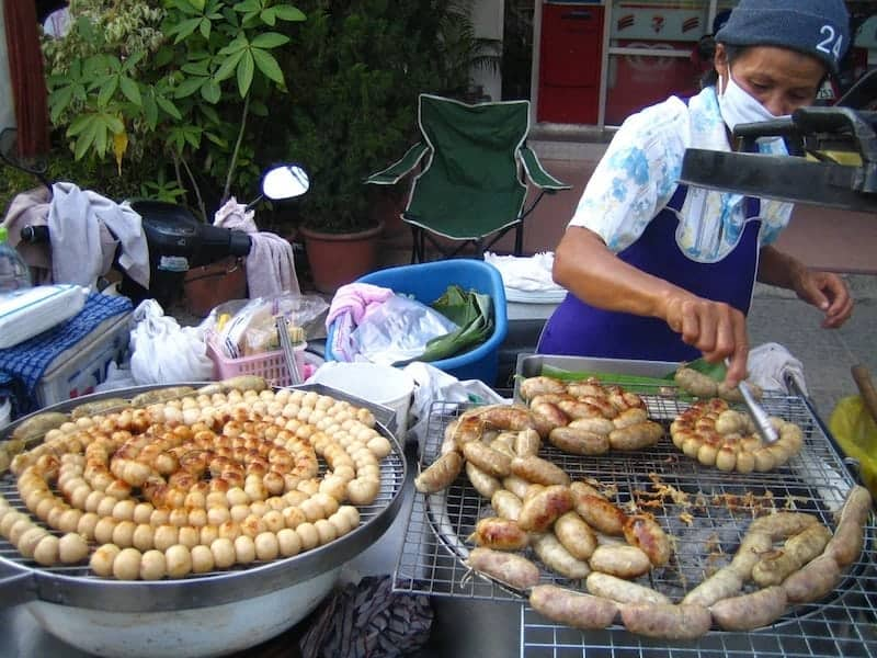 Foodie Travel favourites small round Thai spicy sausages cooked on an outdoor grill