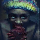 Aurie Parris eats a heart for Halloween