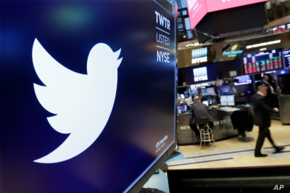 In this Feb. 8, 2018, file photo the logo for Twitter is displayed above a trading post on the floor of the NY Stock Exchange.