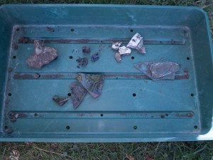 Finds Tray with broken pottery, glass and burnt coal