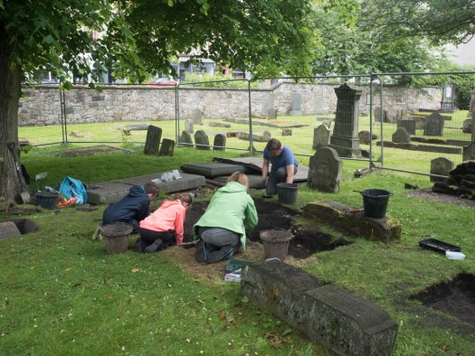 Three McLaughlins and a Seaborne uncovering another two gravestones