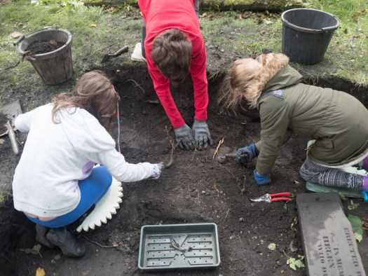Katy, Alexander and Mhairi working on Sunday's discovery