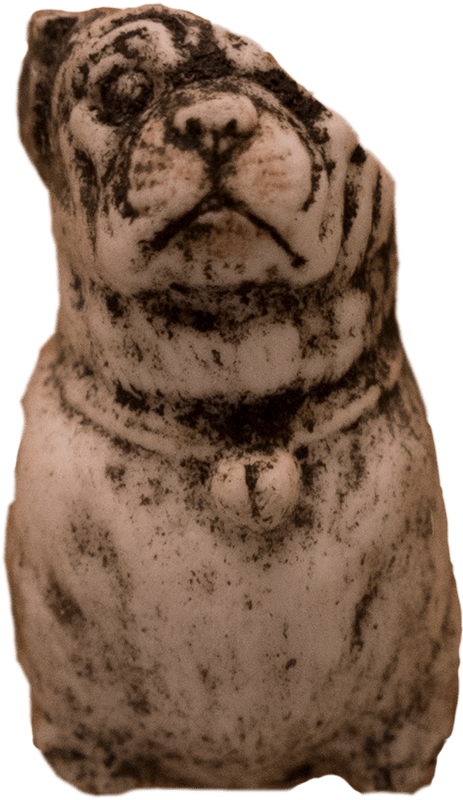 Small, ornamental, ceramic dog found during graveyard dig