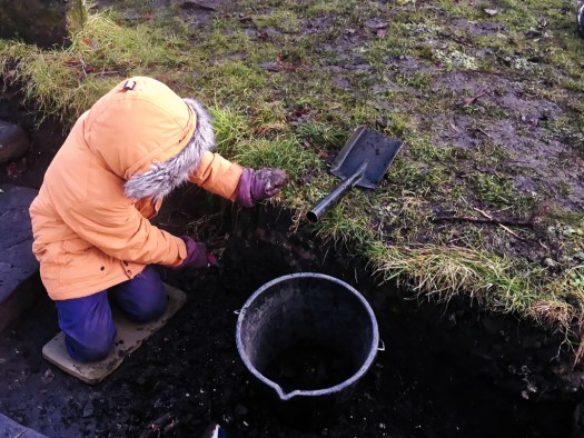 Young archaeologists like to keep their trench edges tidy.
