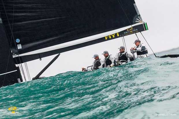 Chris Bake at the helm of Team Aqua as they disappear behind a wave - RC44 Sotogrande Cup © Martinez Studio