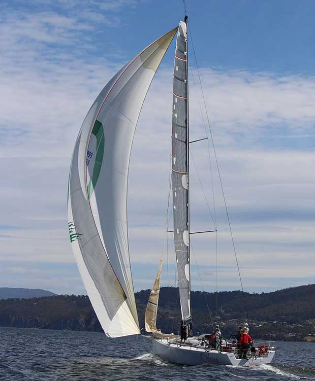 The Cookson 50 Oskana, a Tasmanian entry for the Rolex Sydney Hobart, had a luckless day, becalmed down the river and losing he big lead. © Peter Watson