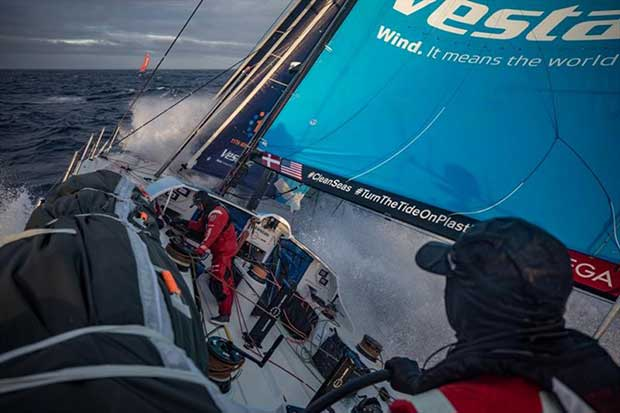 Volvo Ocean Race Leg 7 from Auckland to Itajai, day 05 on board Vestas 11th Hour. Toni Mutter helming while Tom Johnson is fixing the jib, Mapre is now right in front of us. 22 March - photo © Jeremie Lecaudey / Volvo Ocean Race