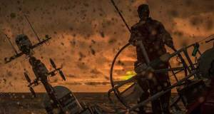 Volvo Ocean Race Leg 9 Newport to Cardiff race start on board Sun Hung Kai/Scallywag. Peter Cumming on the helm during glorious sunset. Day 3. 22 May, 2018. © Volvo Ocean Race