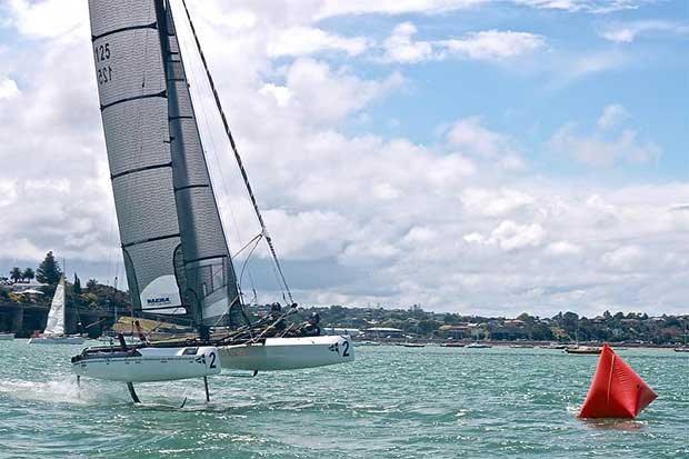 Nacra 20 of the RNZYS Performance Program foiling on the Waitemata Harbour in perfect flat water foiling conditions © RNZYS