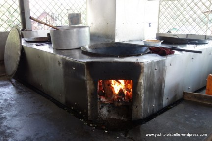 Food preparation over wood fires. All food provided by donors