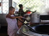 Novice monk helping himself? ...