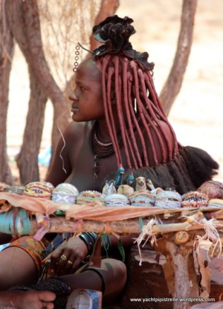 Himba woman clothed in ochre powder and little else!