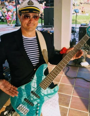 yacht rock bass vocals scotty mcyachty captains hat stripes ybn stage brea concert in the park