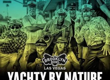 weekend DSB Yacht Rock band Yachty by Nature in captains hats outside Swallow's Inn and posing for a promo for the Brooklyn Bowl Vegas