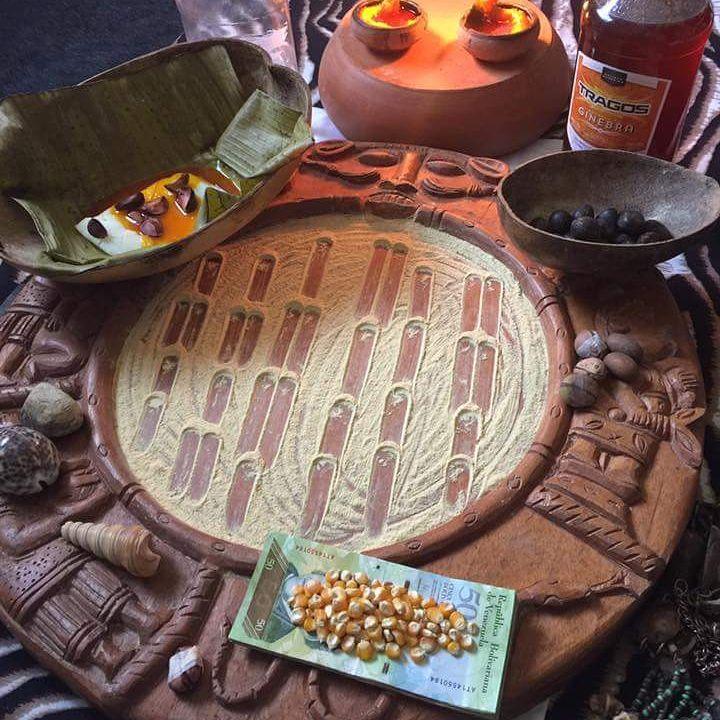 Tray of Ifa with corn and Ikin