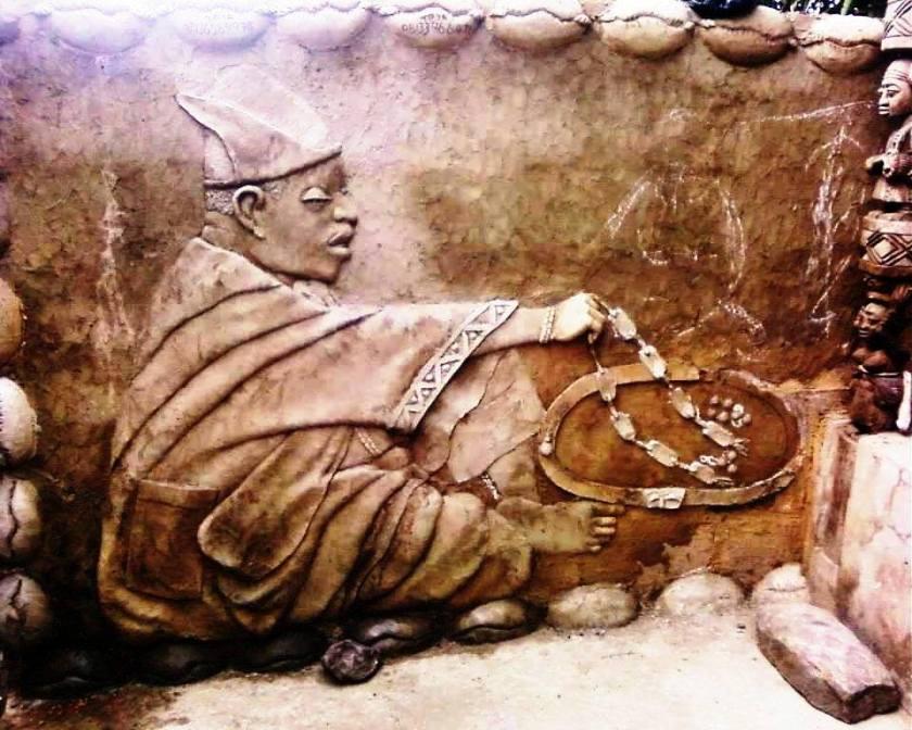 Carving of babalawo throwing opele