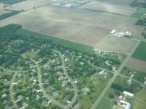 Farmland and neighborhood development coexist near Sun Prairie.