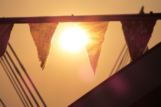 Bunting flags hanging in the sunset at a music festival