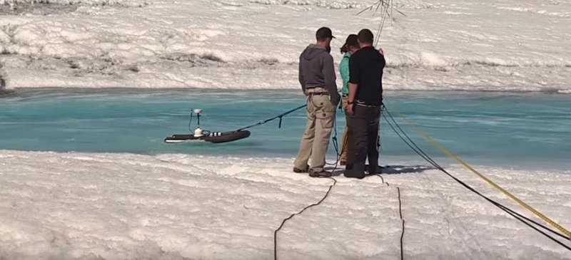 Greenland researchers measuring water flow