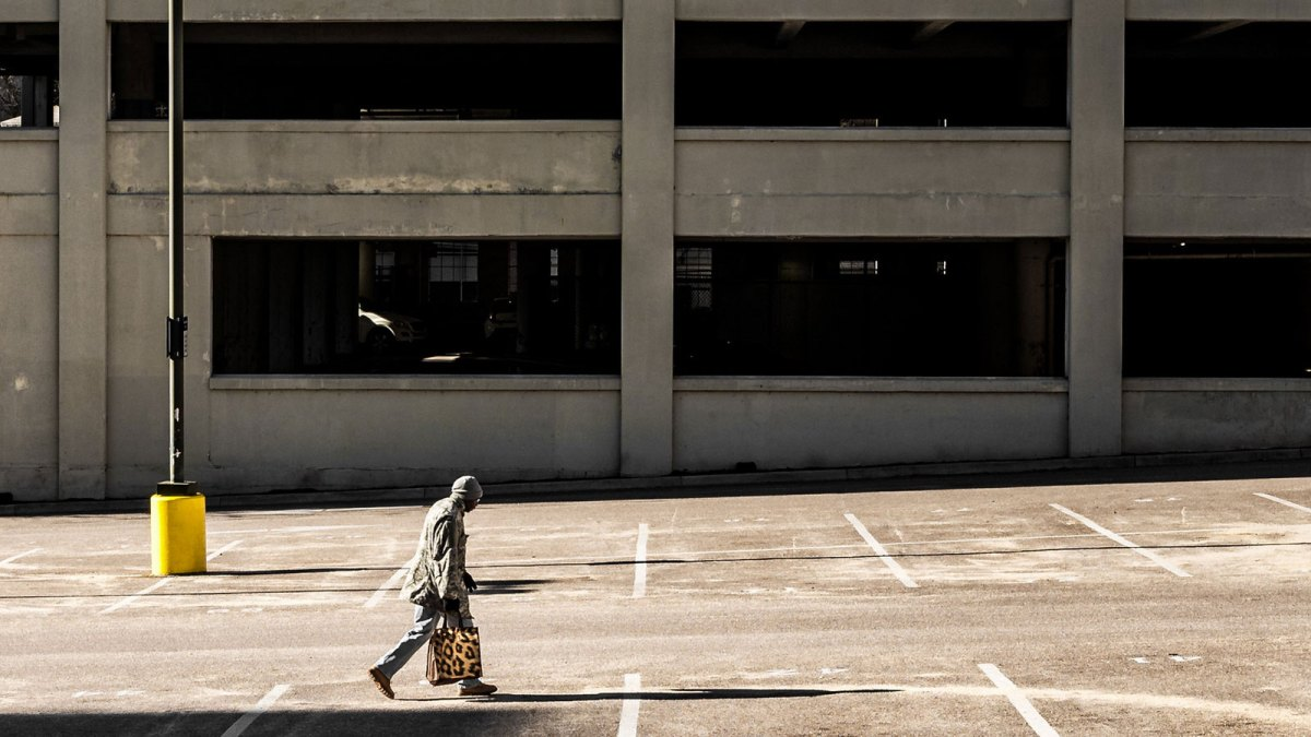 Man walking on cement sidewalk