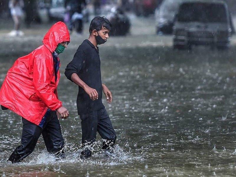 People walking in heavy rain