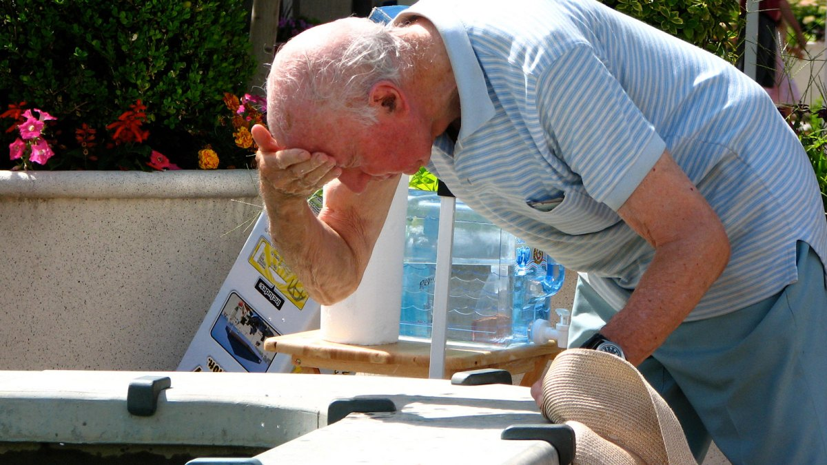 Elderly man cooling off