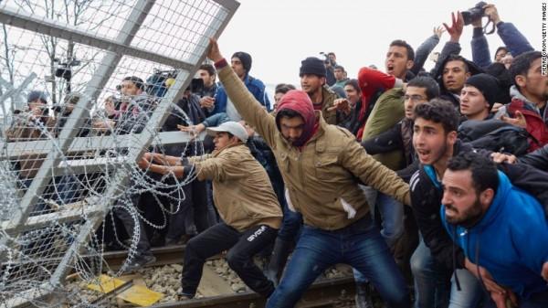 https://i2.wp.com/yalibnan.com/wp-content/uploads/2016/03/Refugees-break-through-a-barbed-wire-fence-Greek-border-with-Macedonia-Feb-262016-e1457404276225.jpg