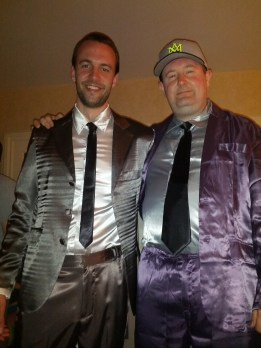 Two guys wearing SuitJamas at a pajama party.