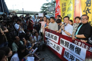 Hong Kong singer Ray Chan together with Leader of the League of Social Democrats Derek Lam and followers are demonstrating against the arrest of 26 people opposed to the Chinese regime