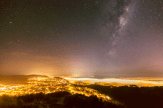 The Milky Way Rises Above A Foggy Wellington, New Zealand by Mark Gee