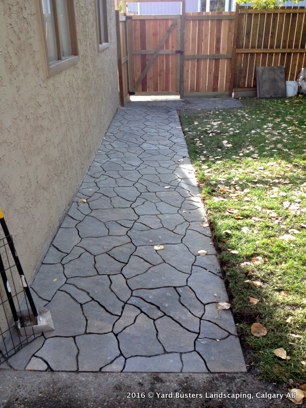 flagstone walkway along the side of the