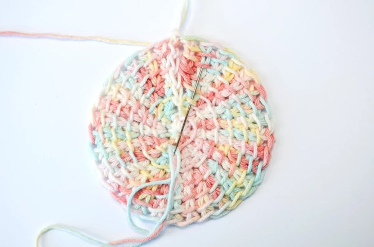 Tunisian crochet face scrubbies - sewing up the gap, starting on the right side