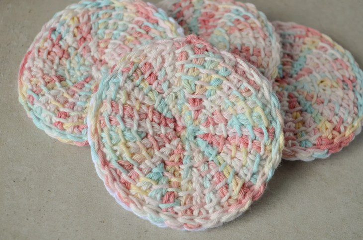 Tunisian crochet face scrubbies in a pile
