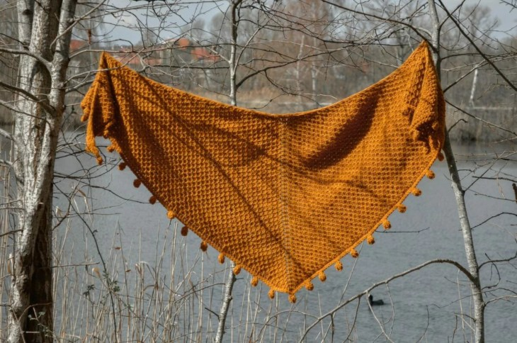 Limonite - Tunisian crochet shawl hanging and showing the crescent shape