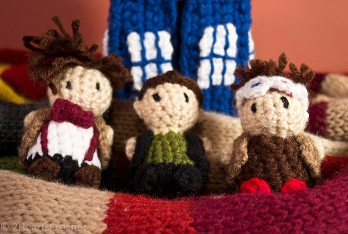 From left to right: Eleven, Nine, and Ten, all wrapped up in my Tom Baker scarf with their TARDIS!